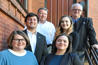 Fall semester's three Vinson Institute Fellows presented the results of their undergraduate internship projects recently at a gathering of Institute faculty and staff.