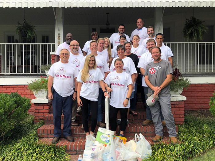Members of the Northwest Georgia Regional Management Development Program outside the Ruth and Naomi Project Homeless Shelter for Women and Children. The group helped rehabilitate a home for the shelter for its service-learning project.