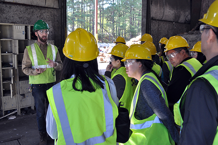 Members of a training delegation from the Shanghai Administration Institute learn how the Athens-Clarke County Recycling Division employs smart technology in its single-stream recycling program from Mason Towe, program education specialist with the county's Recycling Division.