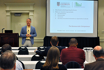 GCCMA President Scott Johnson, the Columbia County administrator, welcomes more than 125 county and city government leaders to the Georgia City-County Management Association's Fall Conference in Athens.