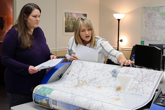 Institute of Government cartographer Angela Wheeler and Kiisa Wiegand with GDOT's Office of Transportation Data led a yearlong effort to update and redesign Georgia's office highway map.