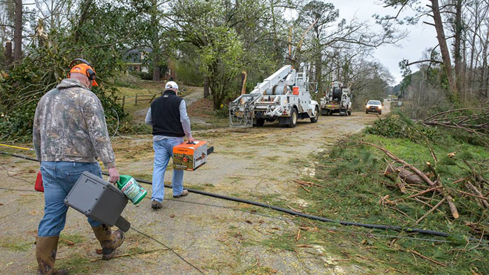 A cleanup crew heads off to help clear storm debris after a tornado March 3. Harris County Commissioner Harry Lange directed a review and update of the county's disaster response plan shortly before the storm, inspired by an Institute of Government emergency preparedness class. Photo courtesy of Columbus Ledger-Enquirer