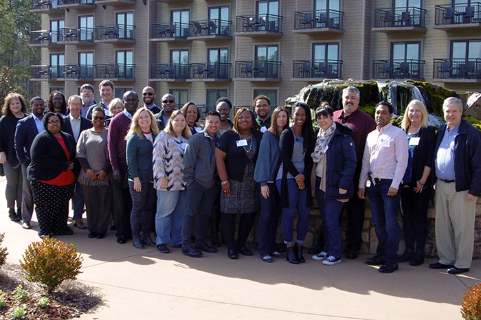 Members of the DBHDD Management Academy's tenth cohort gather for a group photo with lead instructor David Key, far right, at the start of the six-month professional development program.