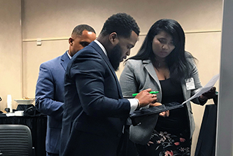 Deidre Kyle, small business development specialist with Palm Beach County, Fla., and North Miami Parks and Recreation Director Derrick Corker work through a problem-solving and decision-making exercise during an NFBPA class that Institute of Government faculty led.