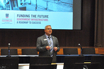 Local government leaders study innovative infrastructure financing techniques with Mark de St. Aubin, who heads Smith, Gambrell & Russell's construction law section, at the Institute's recent Funding the Future symposium.
