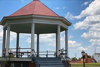 The historic military parade ground was purchased by the city and was used for a school in addition to a public park. The original bandstand, pictured, still stands on the grounds.